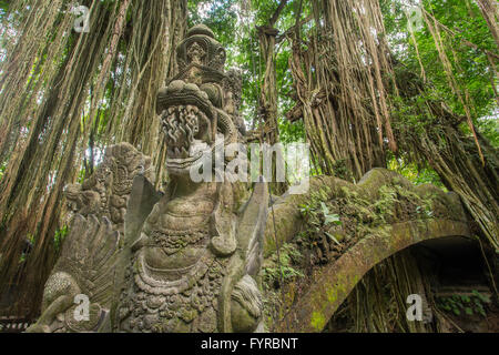 Famous dragon bridge in Monkey Forest Sanctuary in Ubud, Bali, Indonesia - Stock Photo