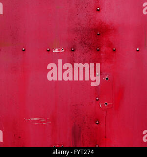 Riveted red metal. Abstract painted matte red metal background texture with rivets. Red metal background - Stock Photo