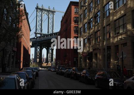 View toward Manhattan down Washington Street in DUMBO, Brooklyn as the sun rises to the east - Stock Photo