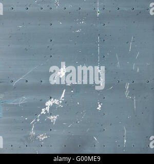 Abstract painted gray metal background. Old texture with rivets. - Stock Photo