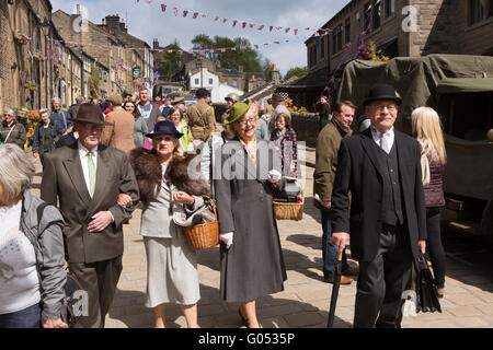UK, England, Yorkshire, Haworth 40s Weekend, visitors in costume walking down Main Street - Stock Photo