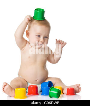 Baby playing with cup toys. Isolated on white back - Stock Photo