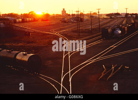 Large industrial railroad yard at sunset; Clovis; New Mexico; USA - Stock Photo