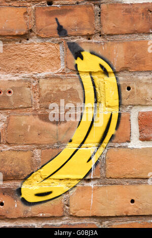 Banana-graffiti on a brick wall, backround - Stock Photo