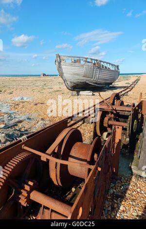 Abandoned old fishing boat on Dungeness shingle beach Kent England UK - Stock Photo