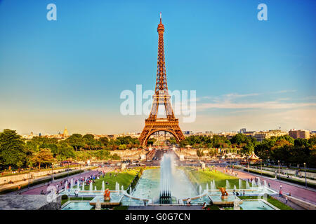 Eiffel Tower seen from fountain at Jardins du Trocadero at a sunny summer day - Stock Photo