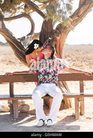 Young couple outdoor portrait. Beautiful pretty girl kissing handsome boy. Sensual photo - Stock Photo