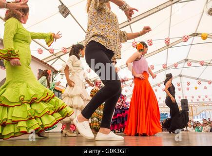 Flamenco dancing lesson at Feria de Abril event. Spain - Stock Photo