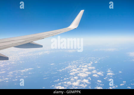 View from th window of a plane of the Wing on sky background - Stock Photo
