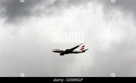 A British Airways passenger jet approaches London Heathrow Airport, Britain April 29, 2016. Copyright photograph - Stock Photo