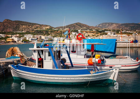 Image of small fishing boats in the village port. Makrigialos, Crete. - Stock Photo