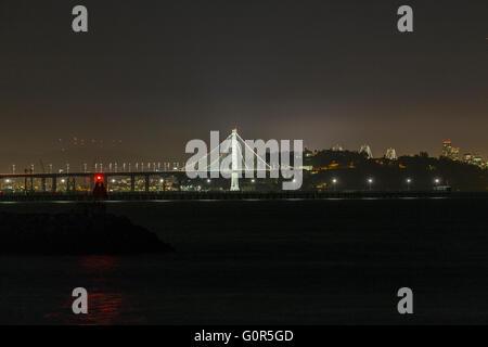 Bay bridge and San Francisco at night. - Stock Photo