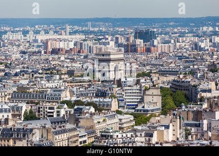 Aerial view of Paris in direction of Arc de Triomphe (Arch of Triumph) from Eiffel tower - Stock Photo