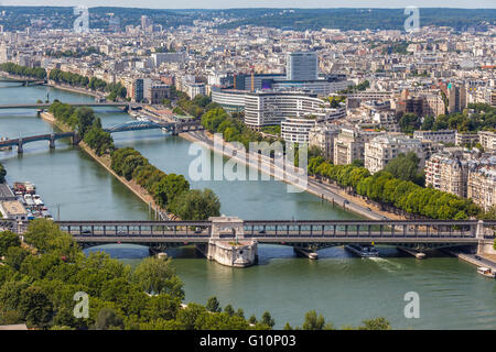 Cityscape of Paris with aerial view from Eiffel tower - the Seine river and residential buildings in morning sunshine - Stock Photo