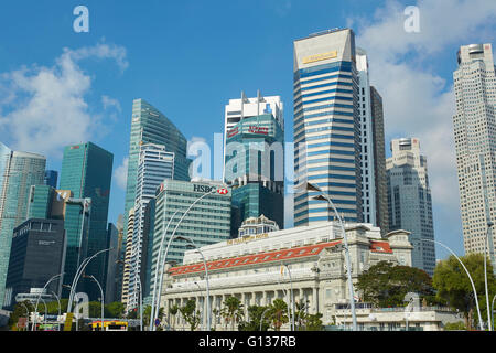 The Fullerton Hotel With The Singapore Business District Skyline Behind. - Stock Photo