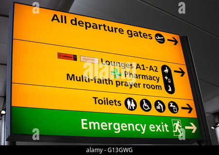 Departure gate sign London Heathrow airport - Stock Photo