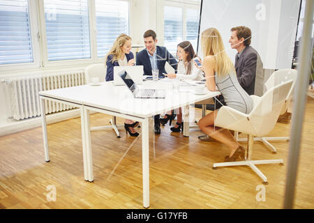 Business people discuss together a strategy in conference room - Stock Photo