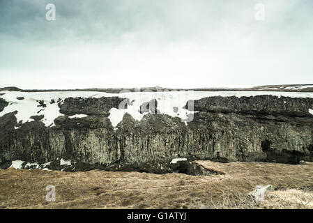 Ice age scenery with snow on mountains in Iceland - Stock Photo