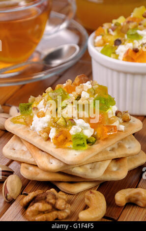 portion of cottage cheese with jam and marmalade, nuts on a cracker - Stock Photo