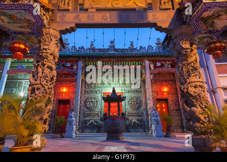 Dusk view of illuminated Hainan Temple, UNESCO Heritage Site, George Town, Penang, Malaysia - Stock Photo