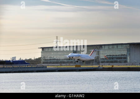 View of an airplane taking off from the London City Airport, UK - Stock Photo