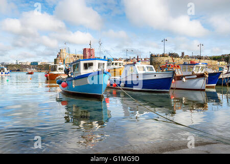 Fishing boats in the harbour at Newquay on the Cornwall coast - Stock Photo