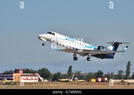 Simferopol, Ukraine - September 12, 2010: Embraer EMB-135BJ business jet is taking off from the airport in the evening - Stock Photo