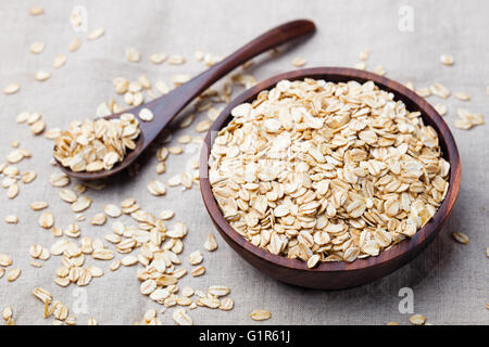 Healthy breakfast Organic oat flakes in a wooden bowl - Stock Photo