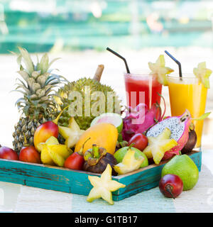 Assortment of tropical exotic fruits with smoothie and fresh juice - Stock Photo