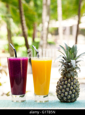 Glass of pineapple and dragon fruit smoothie, juice - Stock Photo