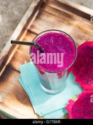 Glass of dragon fruit smoothie, juice and fresh pitahaya - Stock Photo