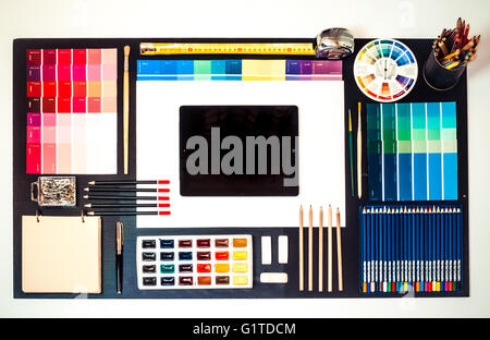 Flat lay of Interior designer and architect working space with tablet - Stock Photo