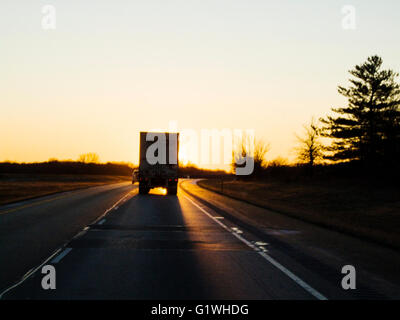 Sunset driver's view of tractor trailer on USA interstate highway 70 - Stock Photo