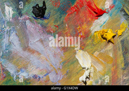 Remains of color strokes oil on wooden plank palette - Stock Photo