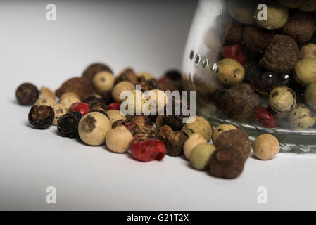 mixed peppers next  to a glass jar - Stock Photo