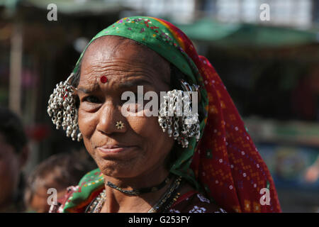 Banjara Caste - Woman wearing silver earrings. Mahur Village, Maharashtra, India - Stock Photo