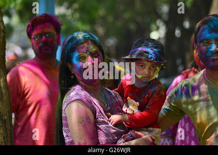 Colorful faces of a family playing Holi (Festival of Colours), Pune, Maharashtra, India - Stock Photo