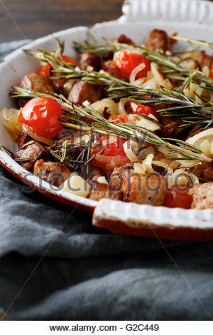 Closeup of Roasted Chicken Meat with tomatoes and spices on frying pan - Stock Photo
