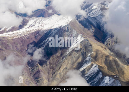 Beautiful view from the aircraft to the mountains of Himalaya - Stock Photo