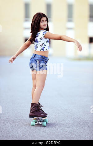 young girl on a skate board - Stock Photo