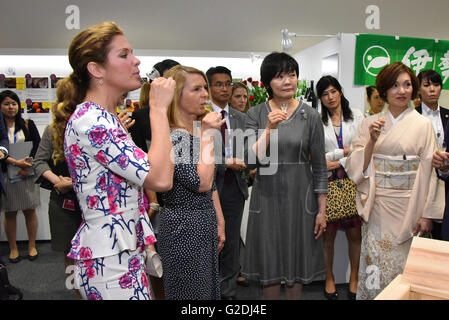 Sophie Gregoire-Trudeau, wife of Canada's Prime Minister Justin Trudeau, left, reacts to a taste of Japanese drink - Stock Photo
