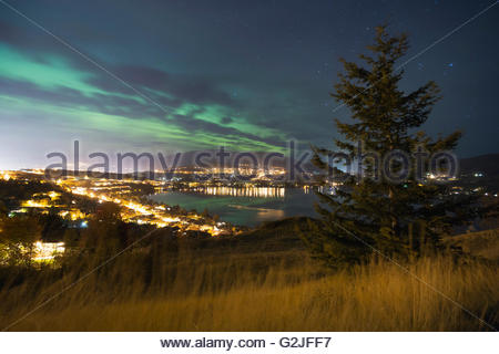 An aurora borealis above the cities of Coldstream and Vernon, North Okanagan Valley, British Columbia, Canada - Stock Photo