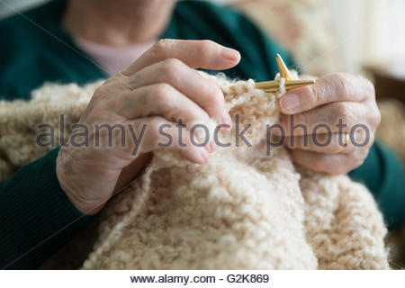Close up senior woman knitting - Stock Photo