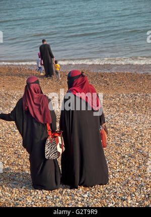 winter beach muslim single women Manchester — police have released a second photo of a man accused of yanking the hijab headdress of muslim woman while  winning single with two outs in  beach .