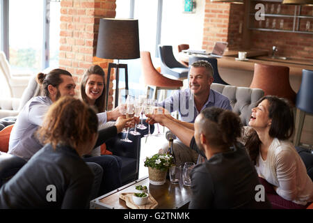 Group Of Friends Celebrating With Champagne In Bar - Stock Photo