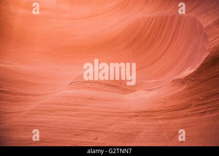 Curving smooth rocks of orange sandstone slot canyon walls. - Stock Photo