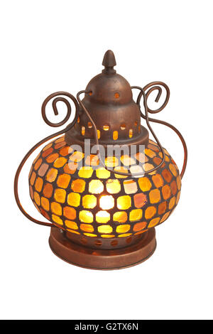 Small oriental lamp with colored glass on a white background - Stock Photo