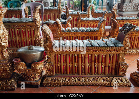 Traditional balinese percussive music instruments instruments for 'Gamelan' ensemble music, Ubud, Bali, Indonesia. - Stock Photo
