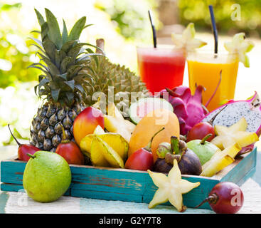 Assortment of tropical fruits, smoothie and juice - Stock Photo
