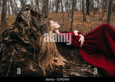 Young witch in the autumn forest - Stock Photo